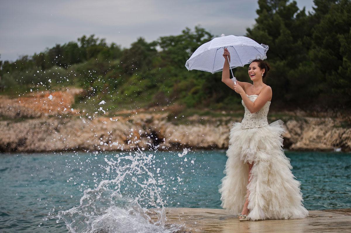 bride with umbrella Dubrovnik