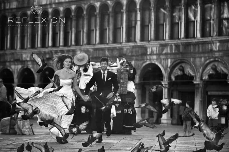 bride and groom in venice running on the san marco square