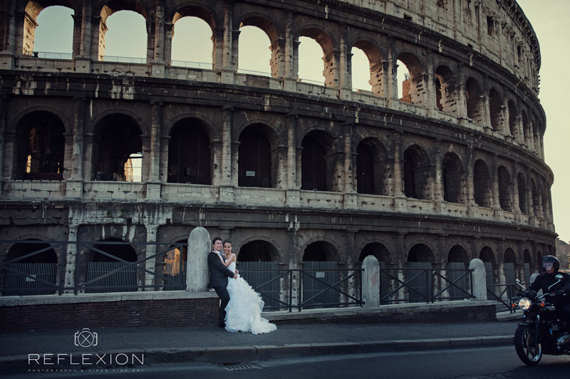 bride and groom near colosseum in rome italy