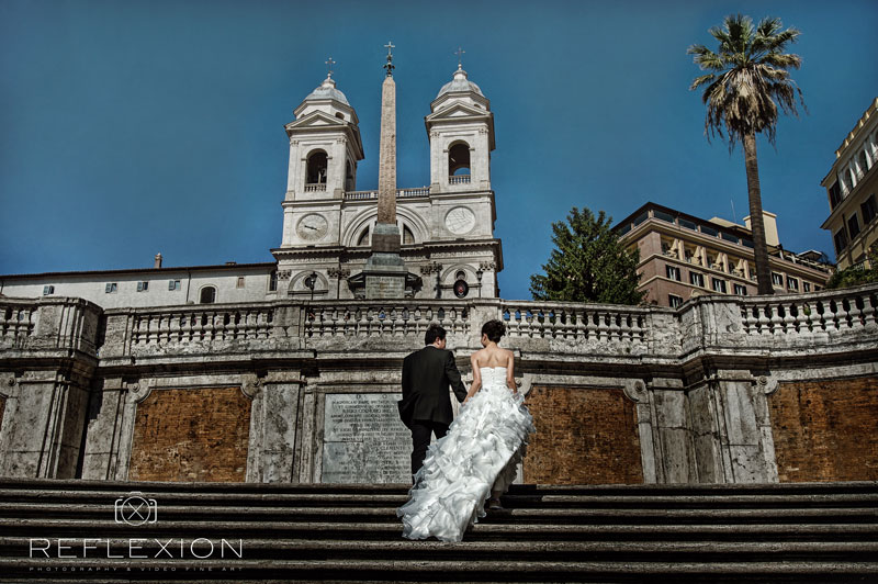 bride and groom walking on the spanish stair in rome