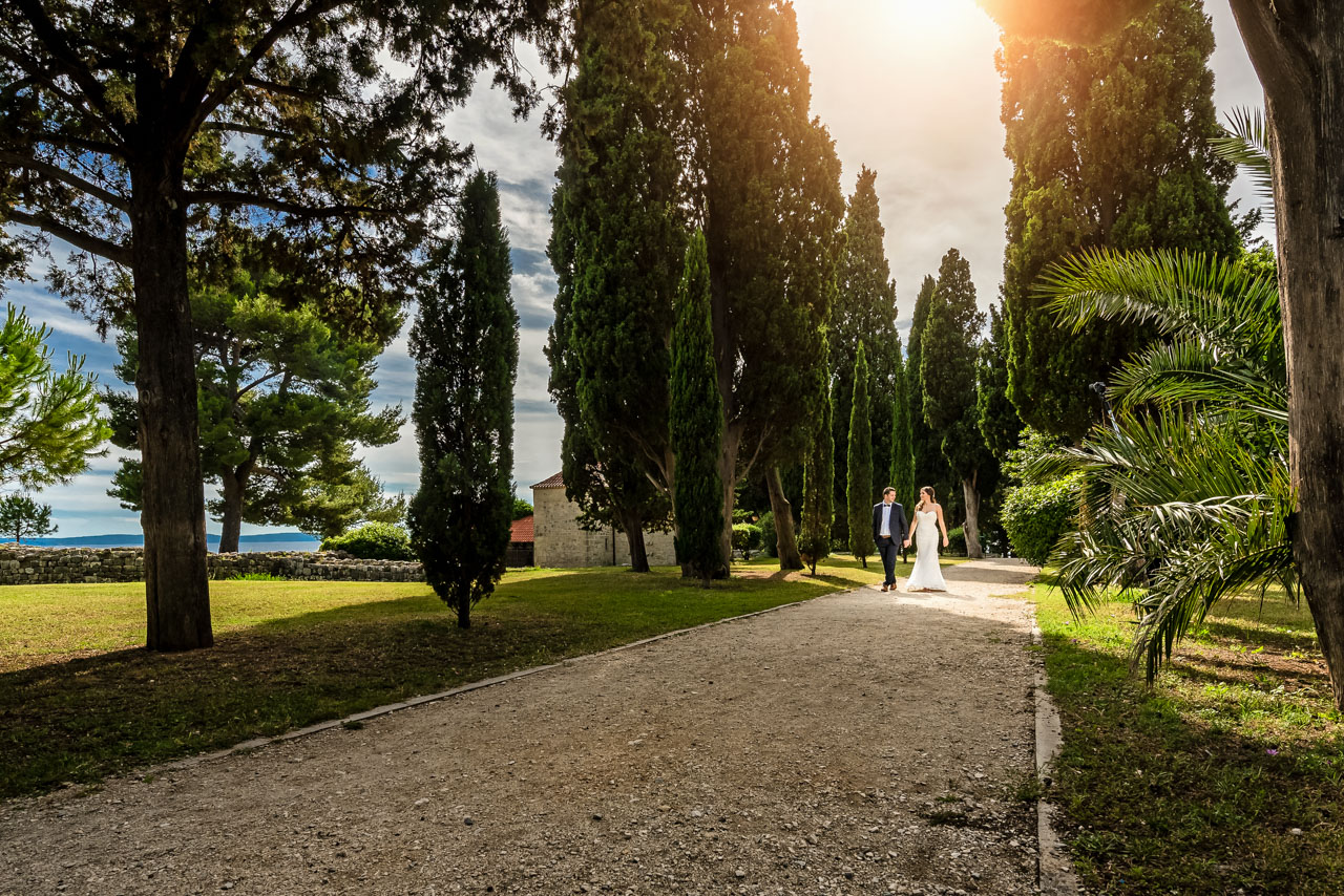 Wedding Photographer Split Croatia bride and groom walking together watching each other
