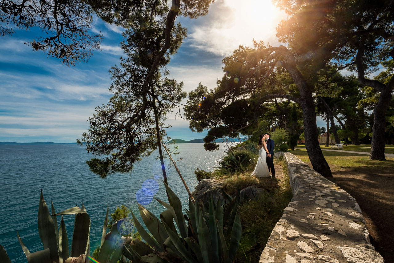 Wedding Photographer Split Croatia beautiful sunset with bride and groom kissing