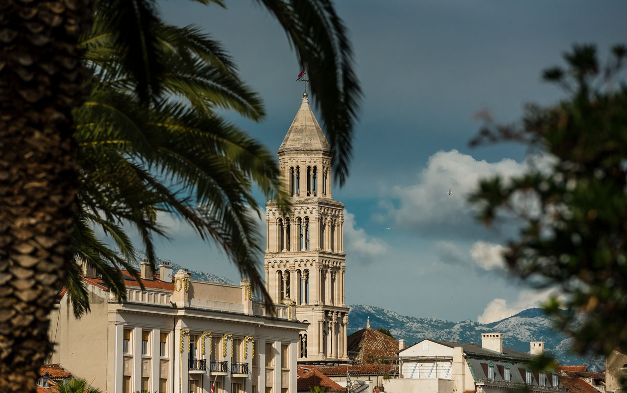 Wedding Photographer Split Croatia church tower with palms in front