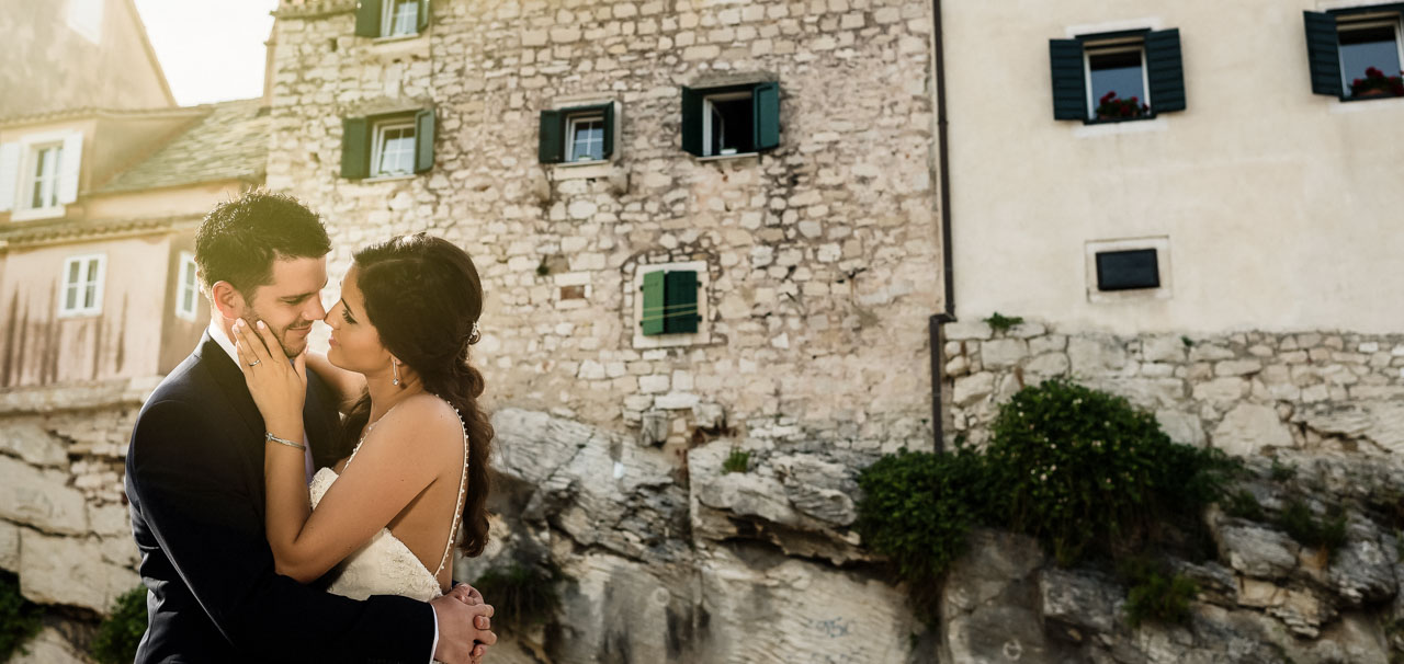 Wedding Photographer Split Croatia portrait of the bride kissing the groom close up shoot