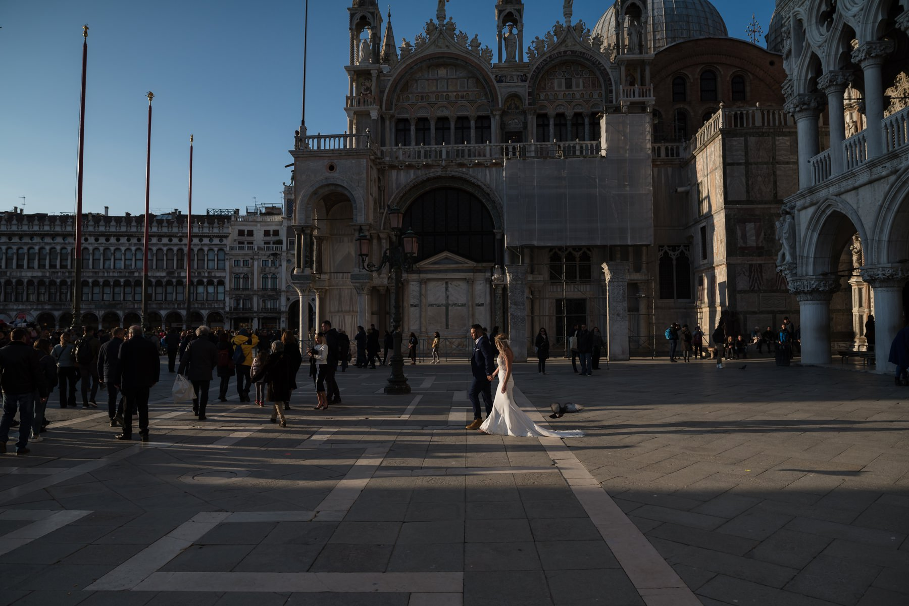Palazzo Cavalli Venice bride and groom walking on San marco