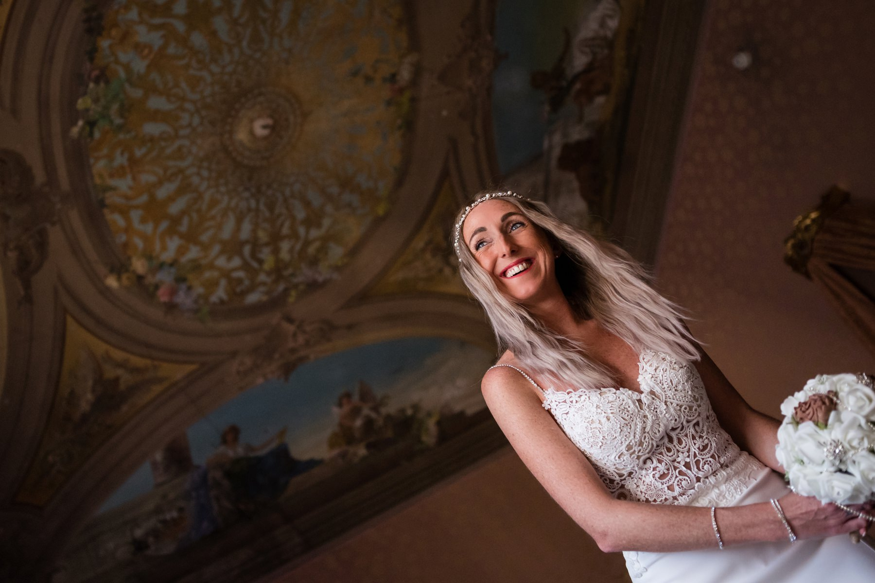 Palazzo Cavalli Venice bride portrait holding the flowers with celling background
