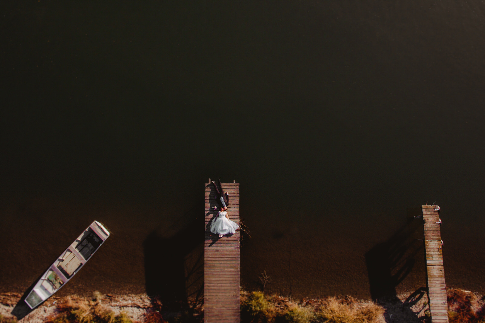 aerial wedding photography bride and groom together on the dock