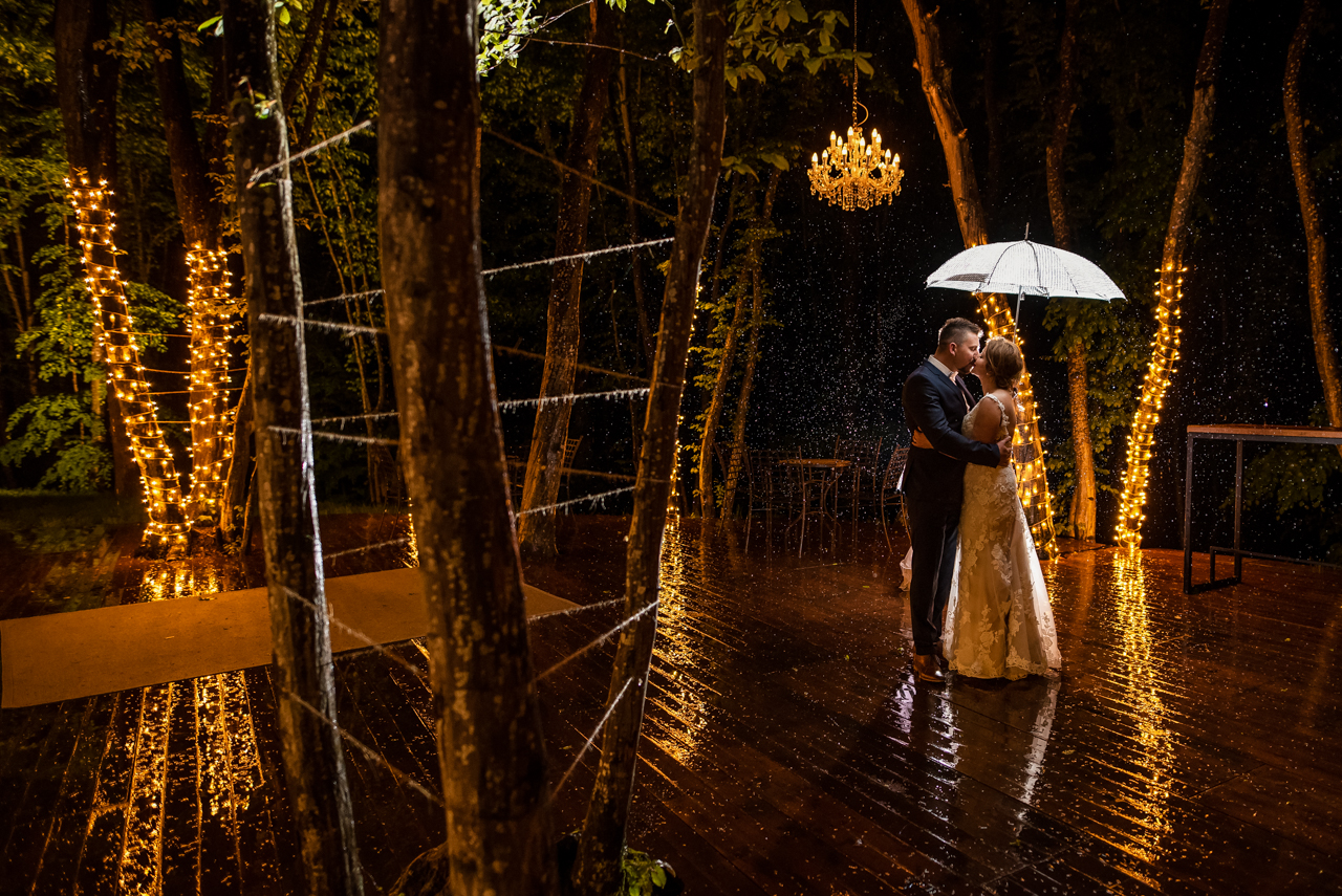 bride and groom kissing each other on the terrace of the corberon resort