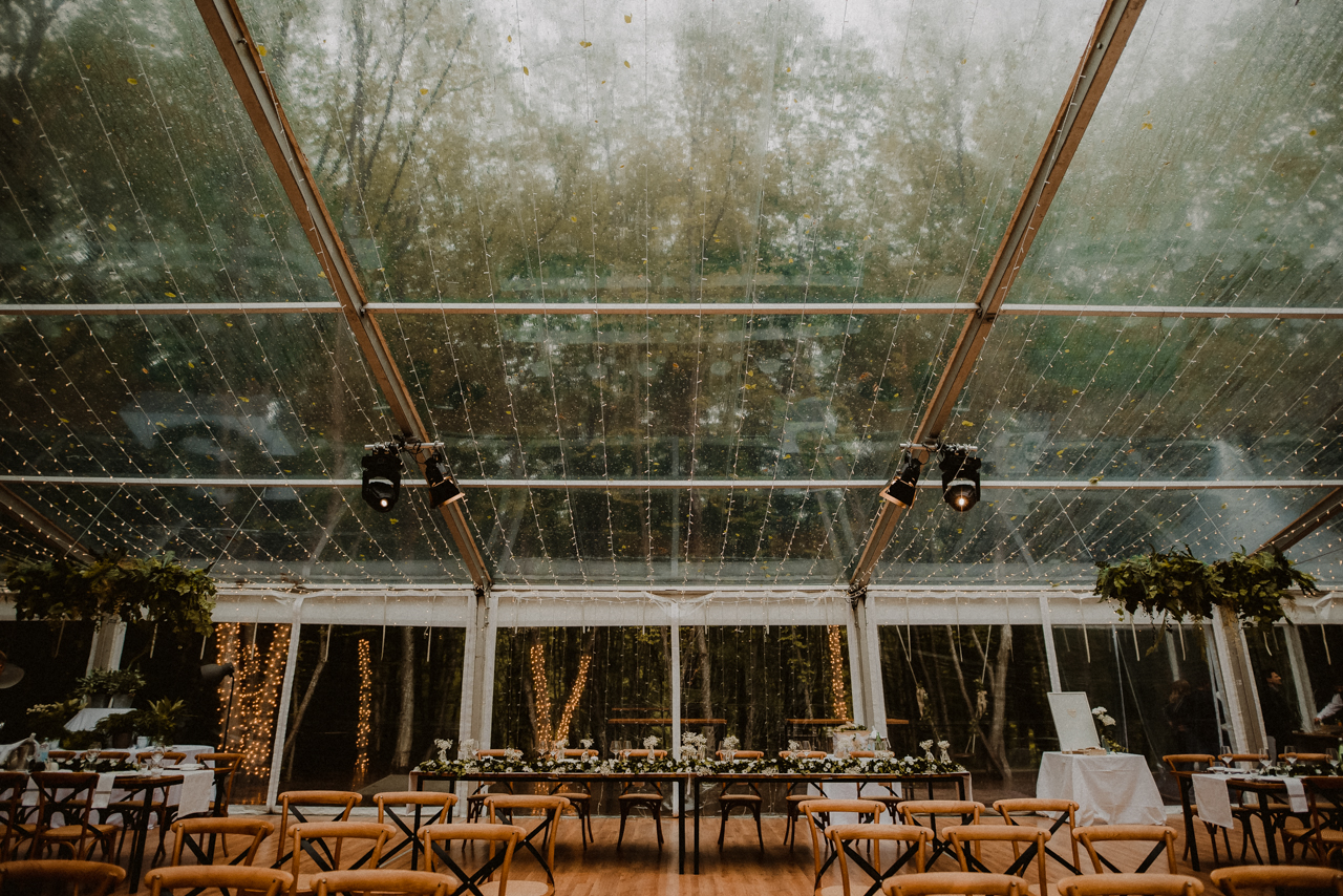glass tent in corberon resort with brown chairs and white flower decors