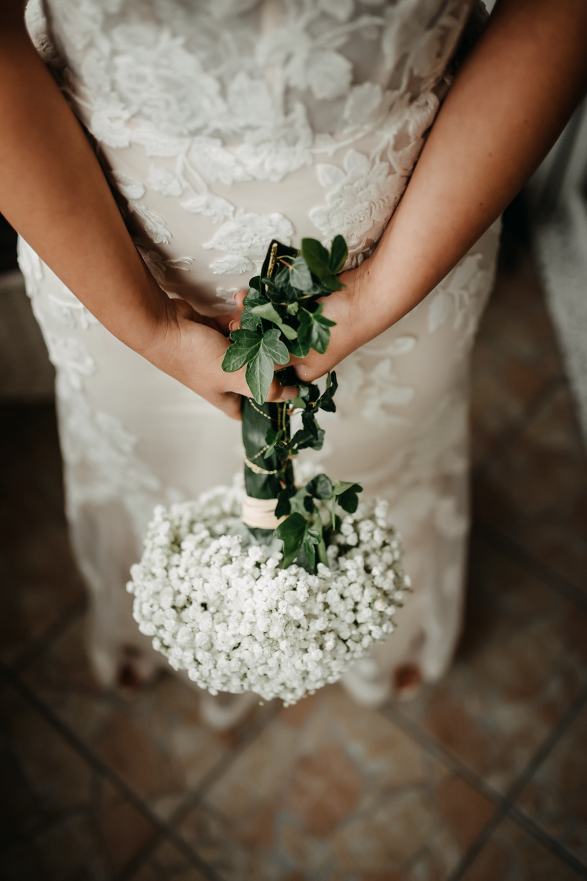 the bride holding hers white flowers
