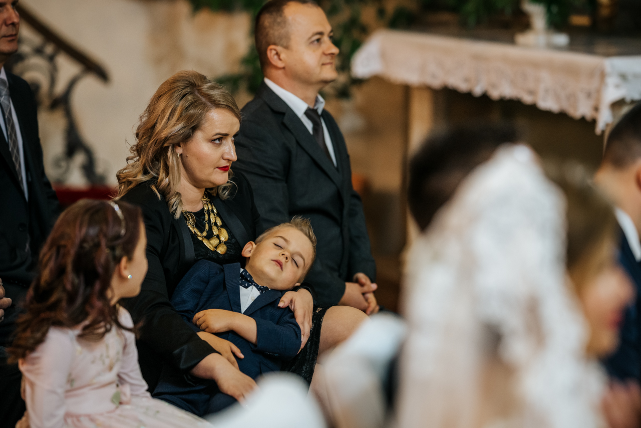 kid sleeping in the middle of the ceremony