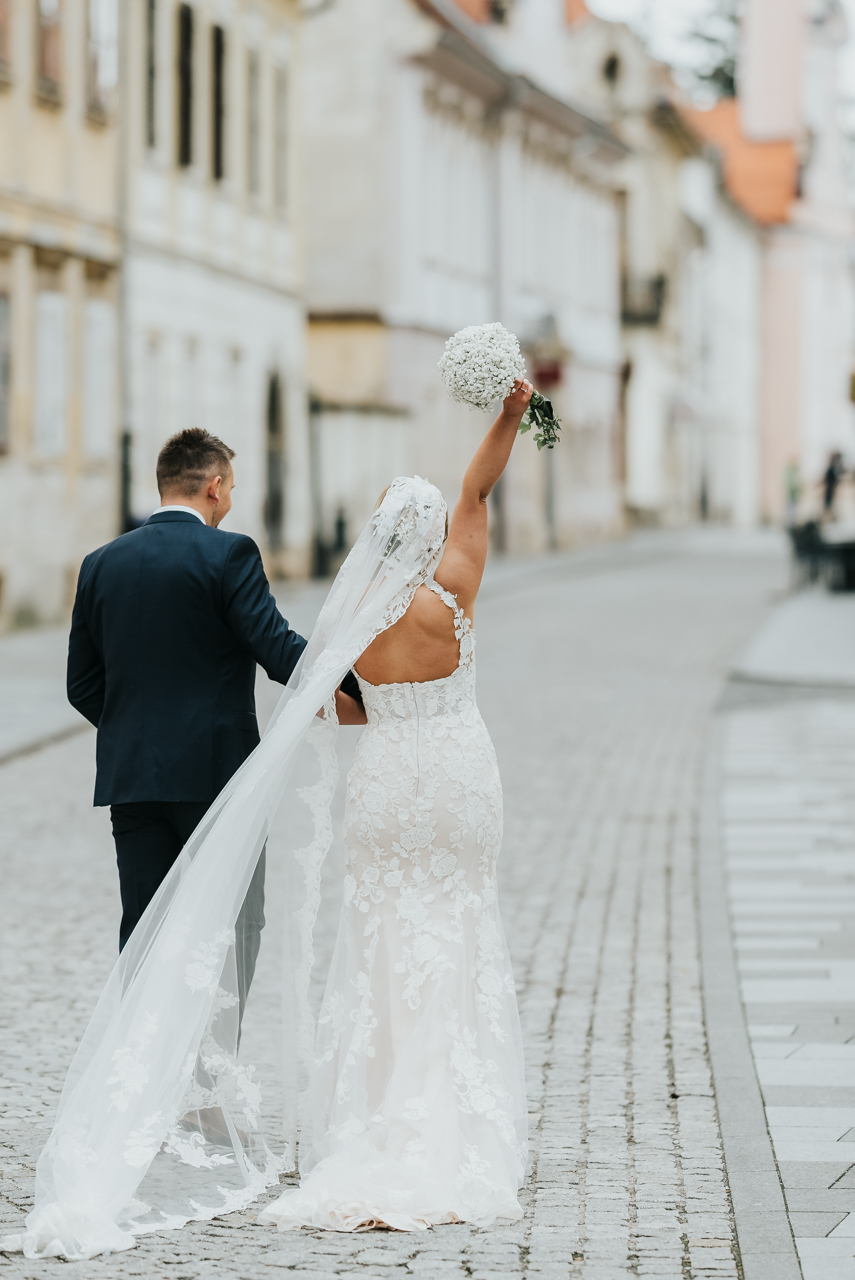 back shoot bride groom walking down the street