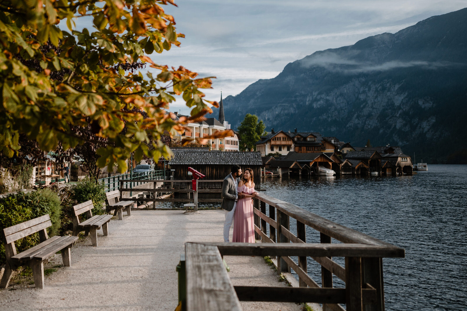 cuople standing at the dock in hallstatt with wide lens angle shoot