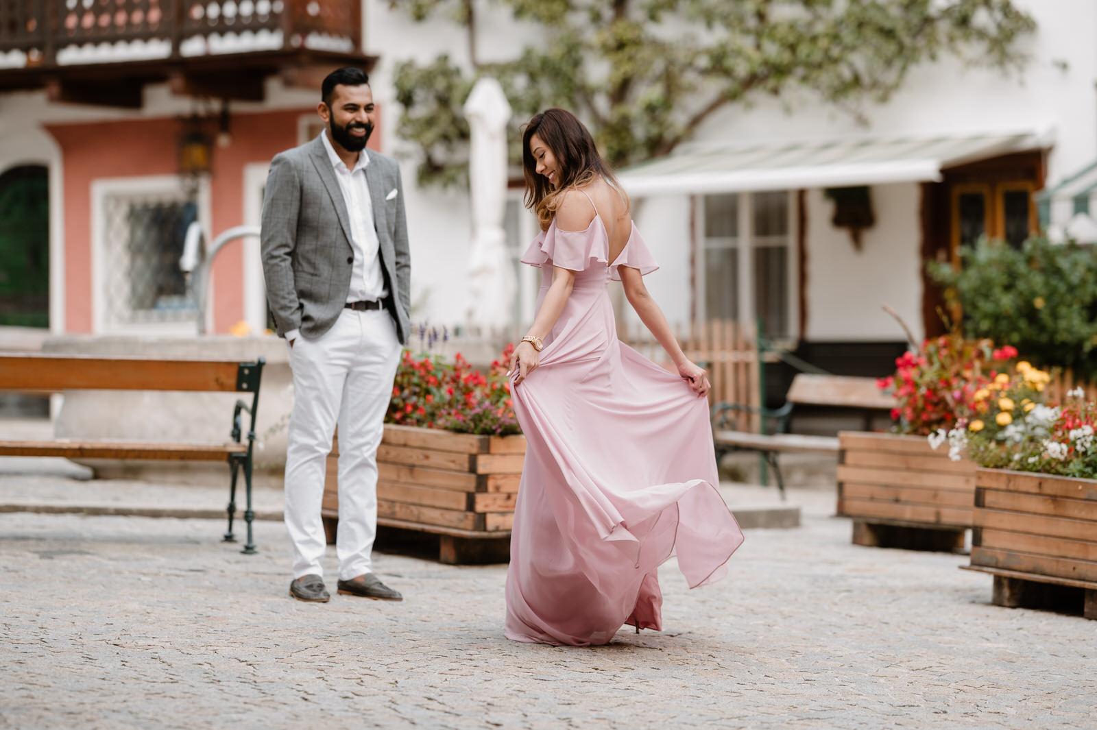 Visha waving the dress in front of her boyfriend