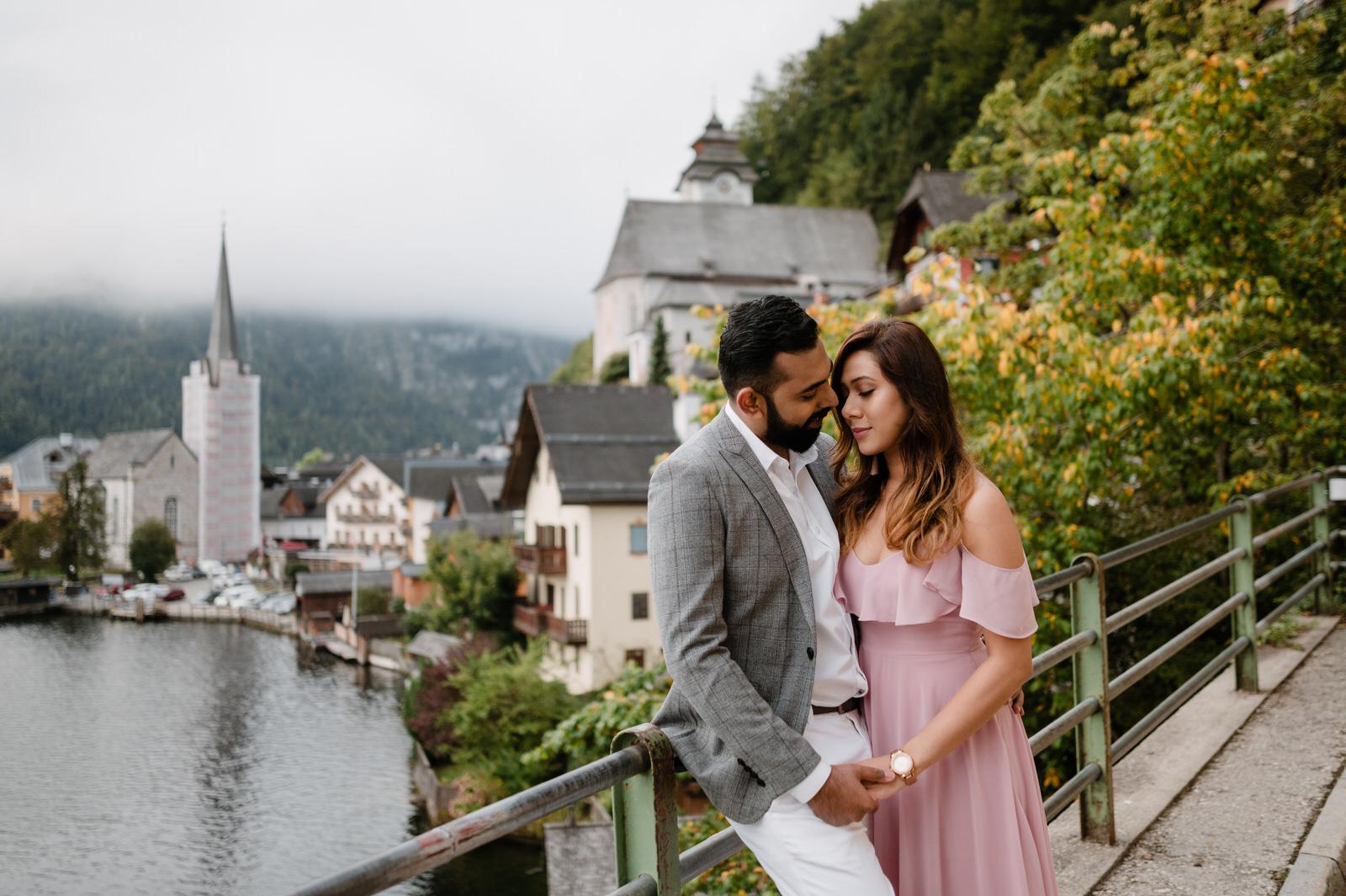 couple standing at the most popular sight in Hallstatt