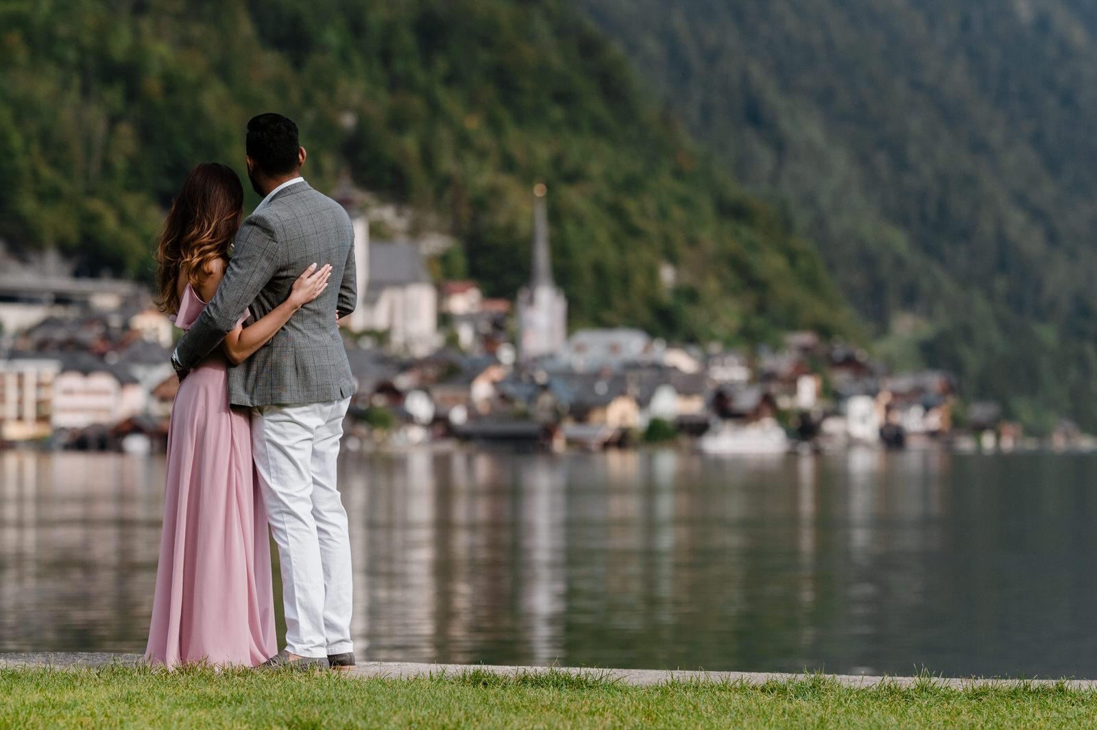 couple together at small island at hallstatt lake