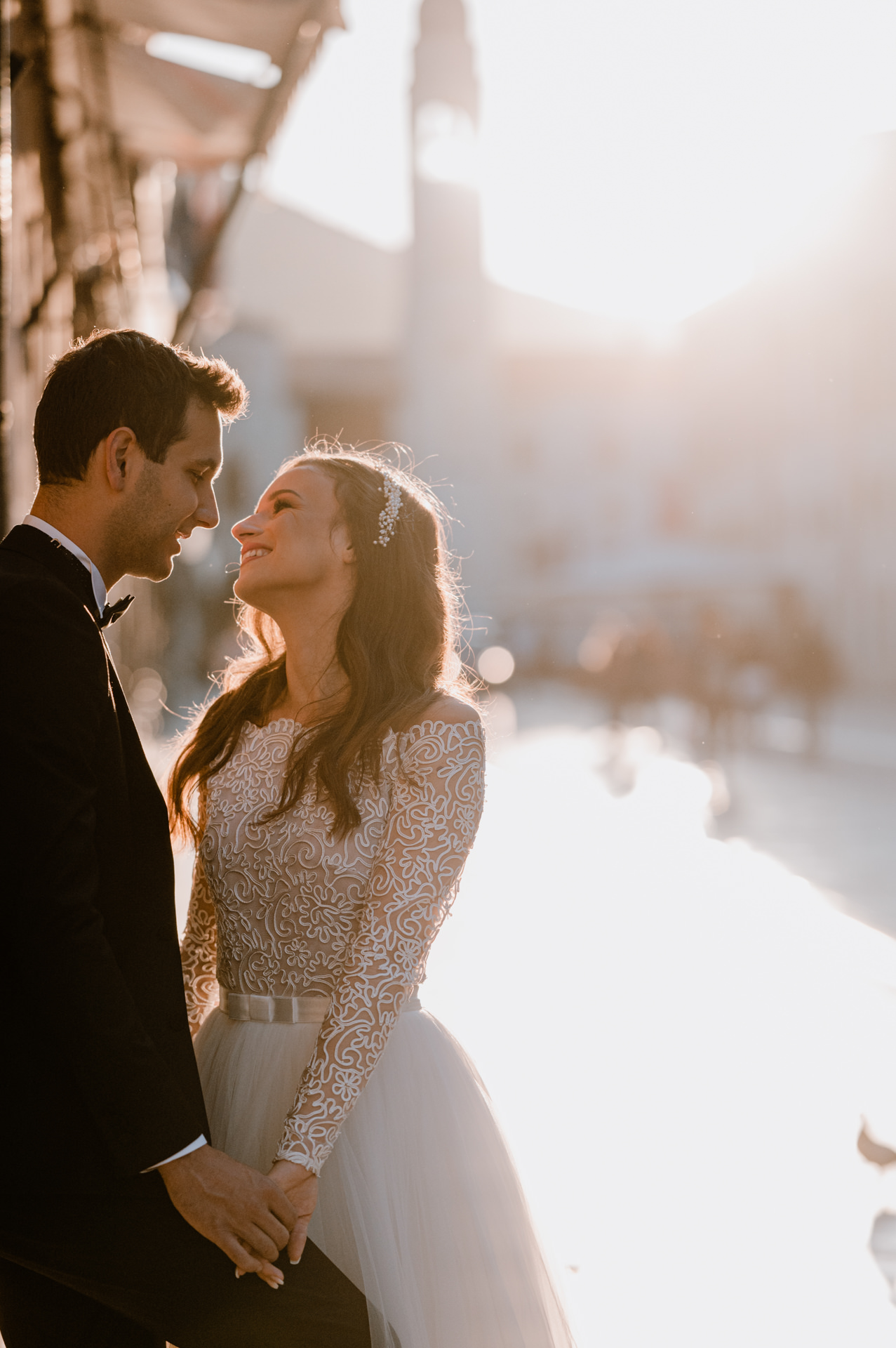 bride and groom smiling at stradun street with sun flare in background
