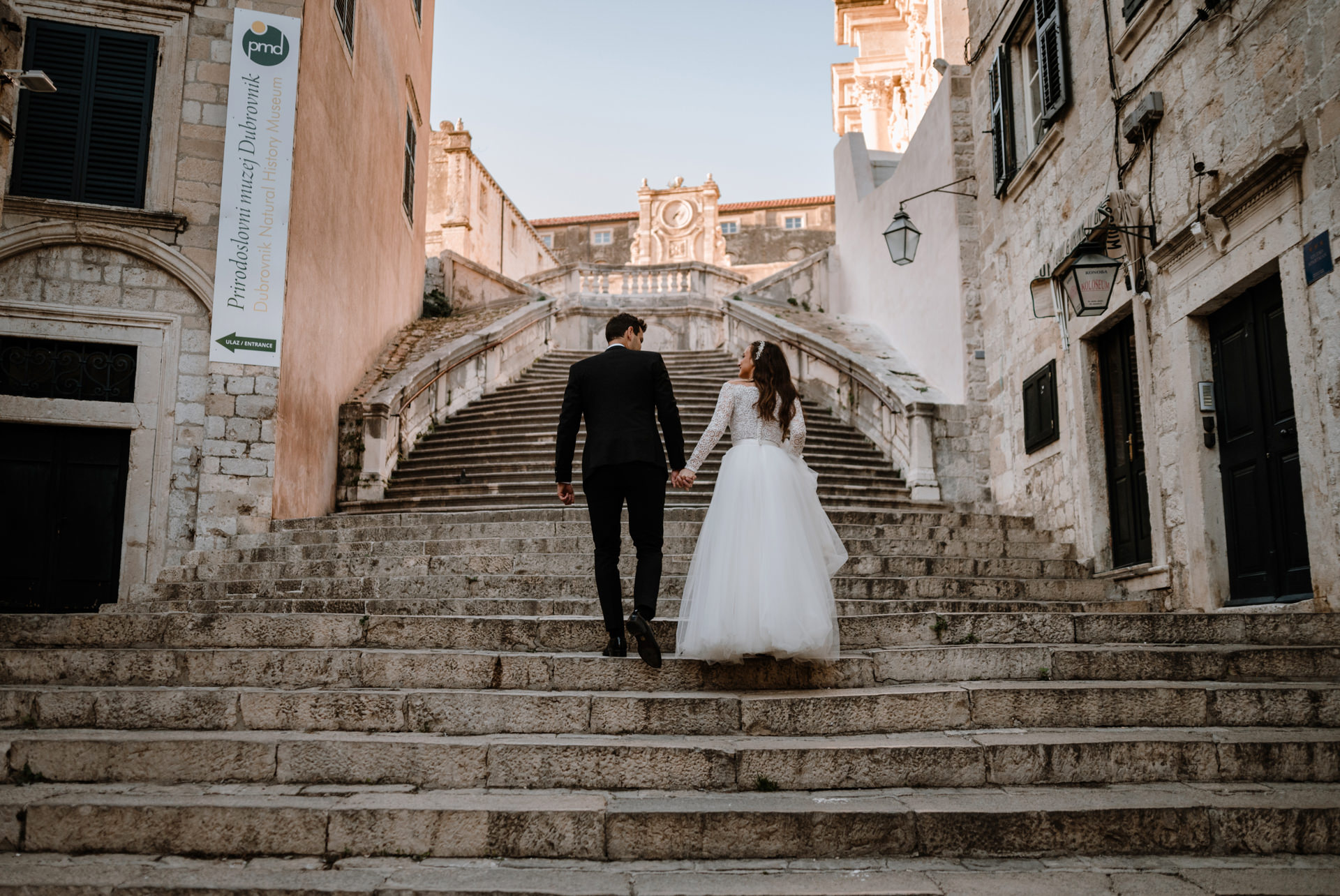 bride and groom walking staircase popular from game of thrones seasson five