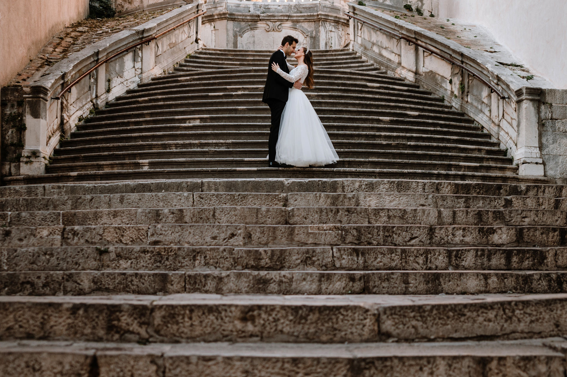 bride and groom standing together at the stairs poplular kings landing in the games of thrones