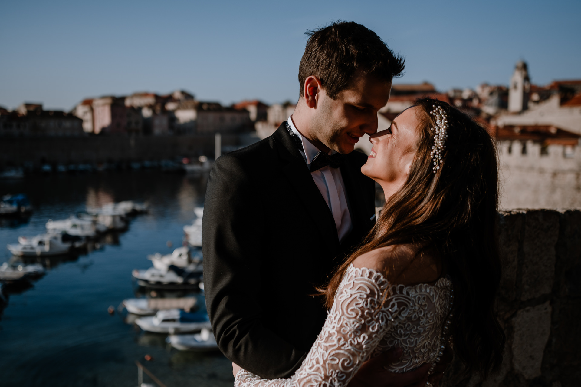 bride and groom close up old harbour dubrovnik
