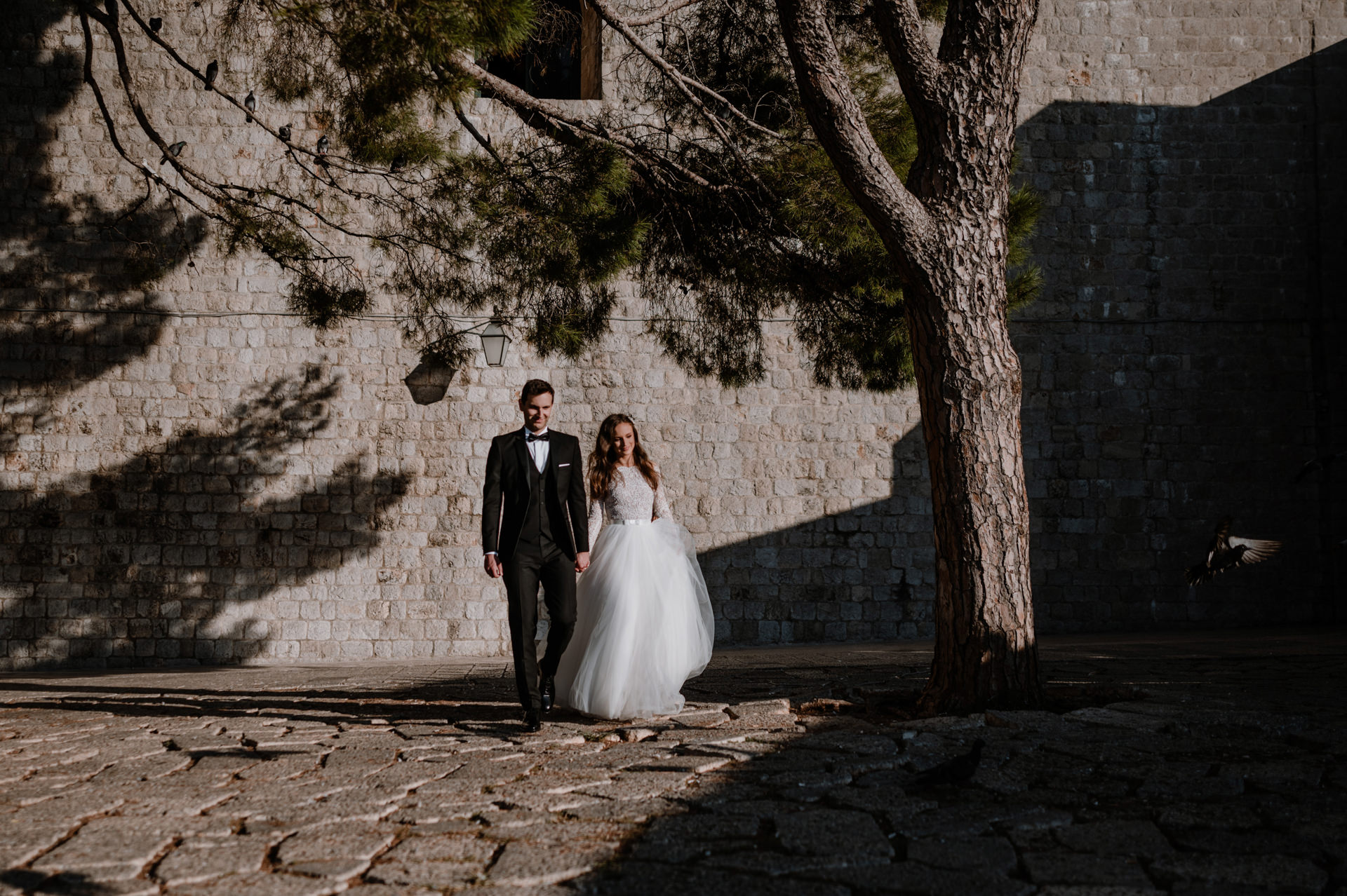 bride and groom together walking and smiling in dubrovnik